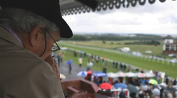 punter in grandstand deciding where to bet